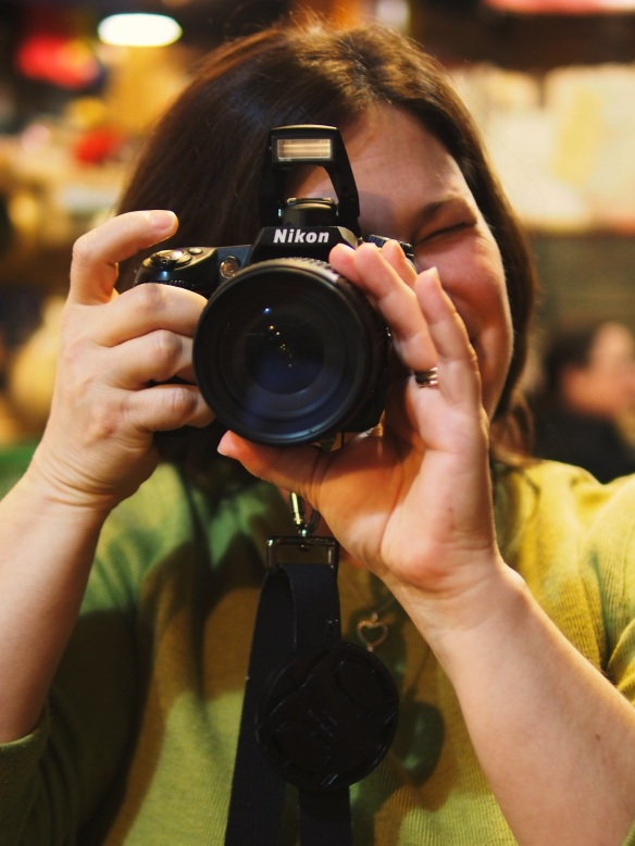 Here's Steph - shooting me shooting her at the Italian Deli about 15 freeways away from the Gift Mart