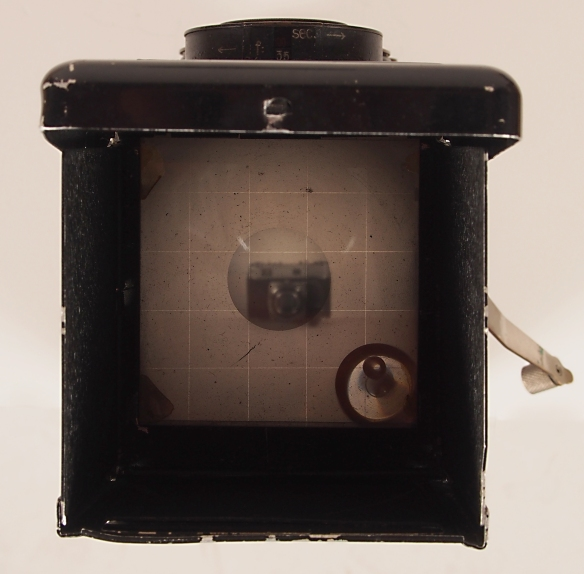Looking through the prism you see everything in reverse. This is the 1930's version of an LCD screen.