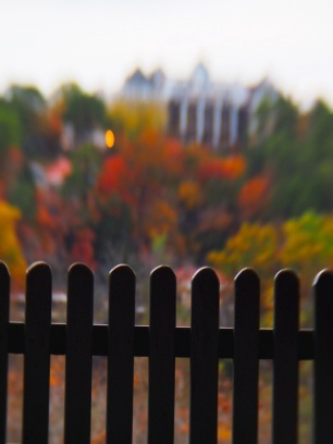 Focusing on the picket fence from the overlook lets everything beyond melt together in a blur of colors. The Crescent sits there atop the trees.