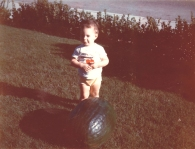 Why my mother loved to contrast me with large objects as a child is still a mystery to me. I also have a shot of me as an infant with a slice of ham covering me like a blanket. Big baby, big object...