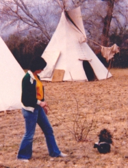 Mom's sense of the silly or ironic would not let her miss this shot of me walking a skunk on a leash in a circle of teepees. This shot pretty much sums up the flavor of my childhood.