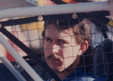 Mom showed me what depth of field was on that first outing with the Rollei - she looked at shots with that in mind. Ron through the cage of the race car. Her little boy all grown up.