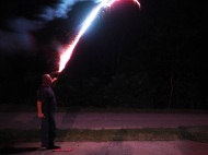Grandpa Shooting off a Roman Candle