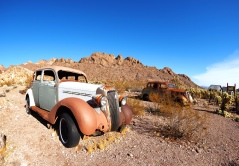 Desert Car Lot - shooting further back lets the landscape curve slightly but magnifies the space.